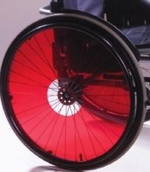 Enjoliveur translucide rouge pour fauteuil roulant